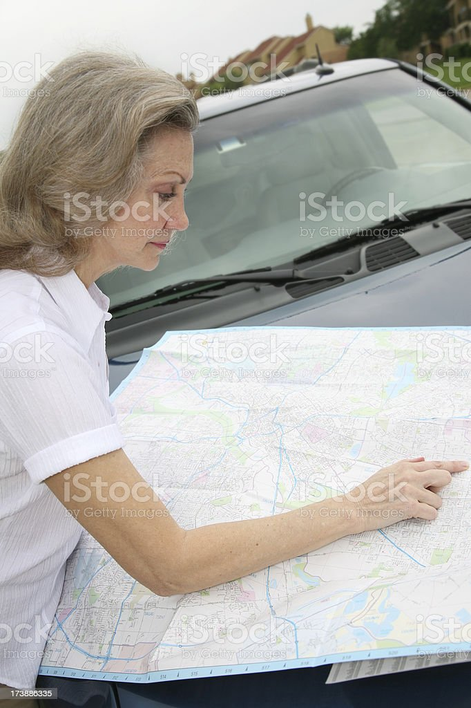 Senior Adult Woman Looking at Directions on her map royalty-free stock photo