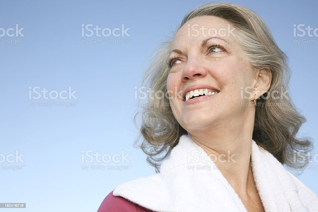 Senior Adult Woman Outside With Exercise Towel royalty-free stock photo