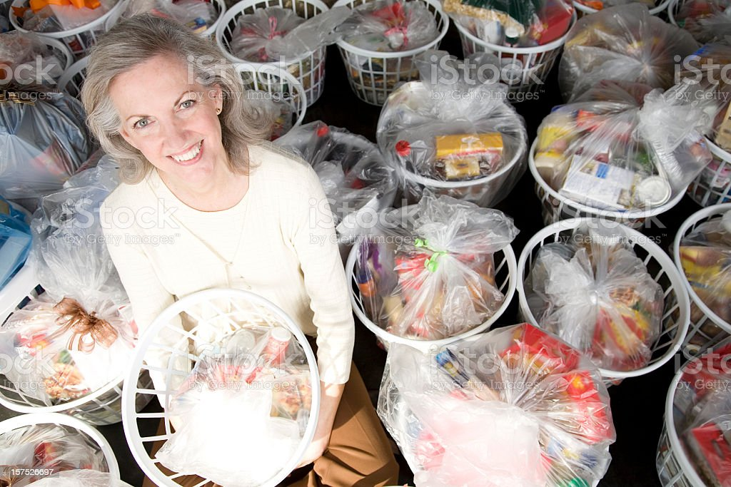 Senior Adult Woman with Baskets Full of Groceries stock photo