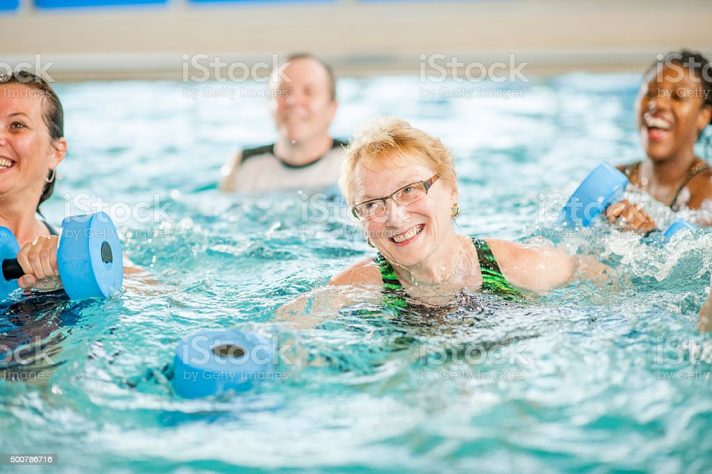Senior Adult Woman Working Out in the Pool stock photo