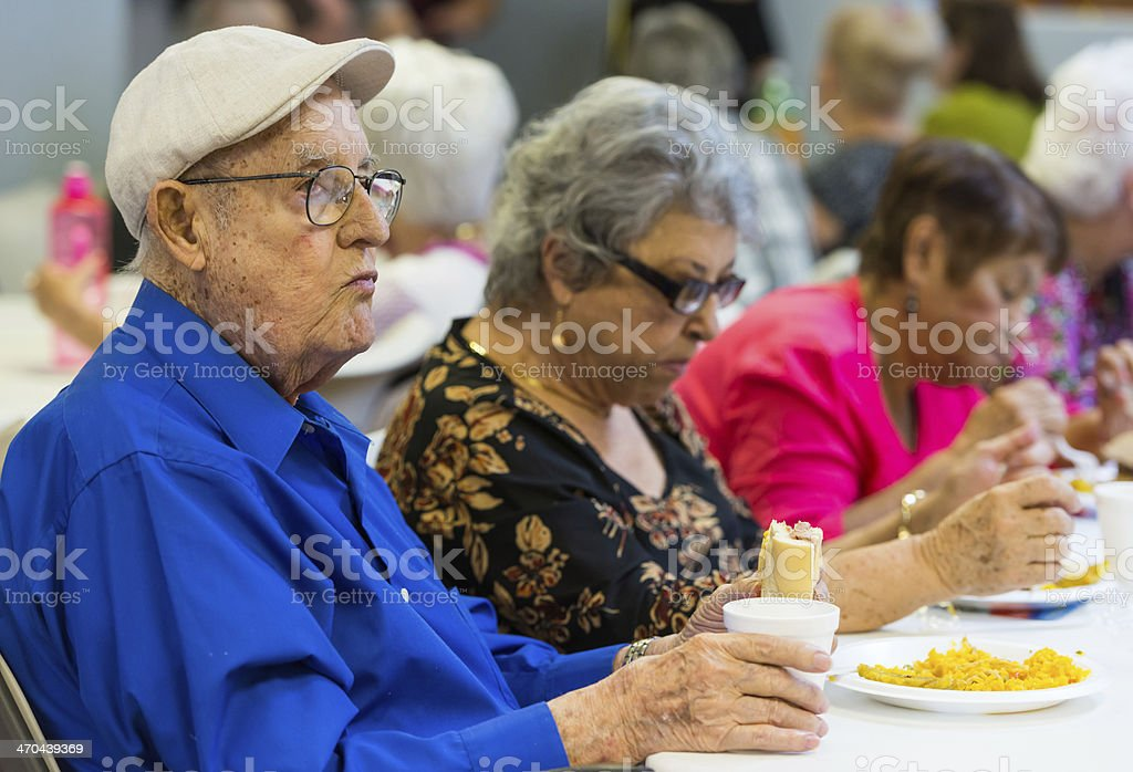 Senior adults having lunch stock photo