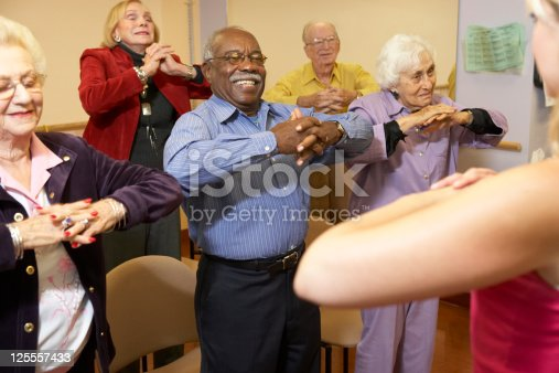 istock Senior adults in a stretching class 125557433