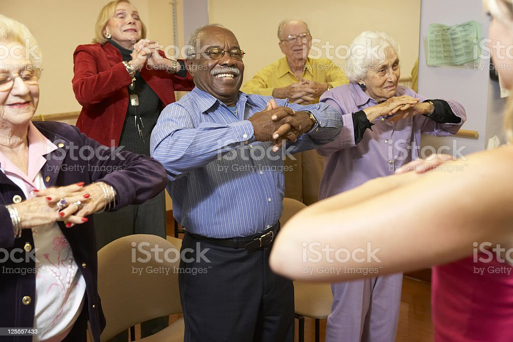 Senior adults in a stretching class stock photo