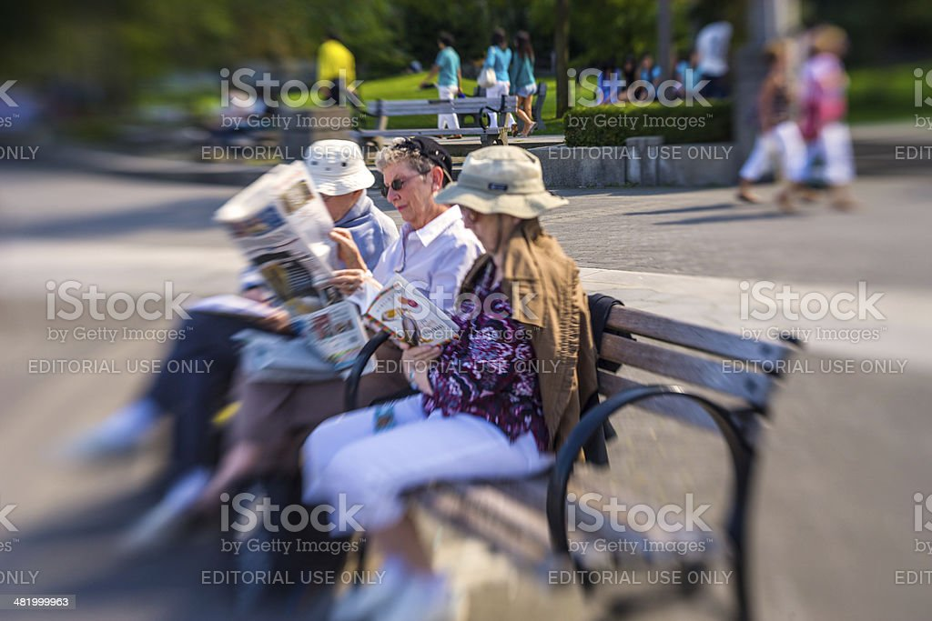 Senior Adults relaxing on a bench in Vancouver, lensbaby stock photo