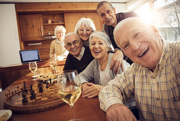 senior adults taking a picture of themselves - game of life stock photos and pictures
