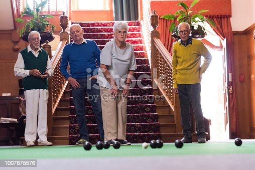 Senior adults watching the last bowl roll to see who wins