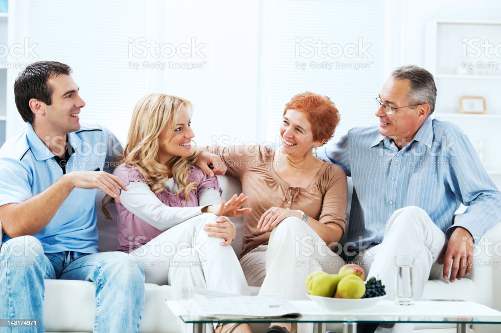 Senior adults with their adult children at home royalty-free stock photo