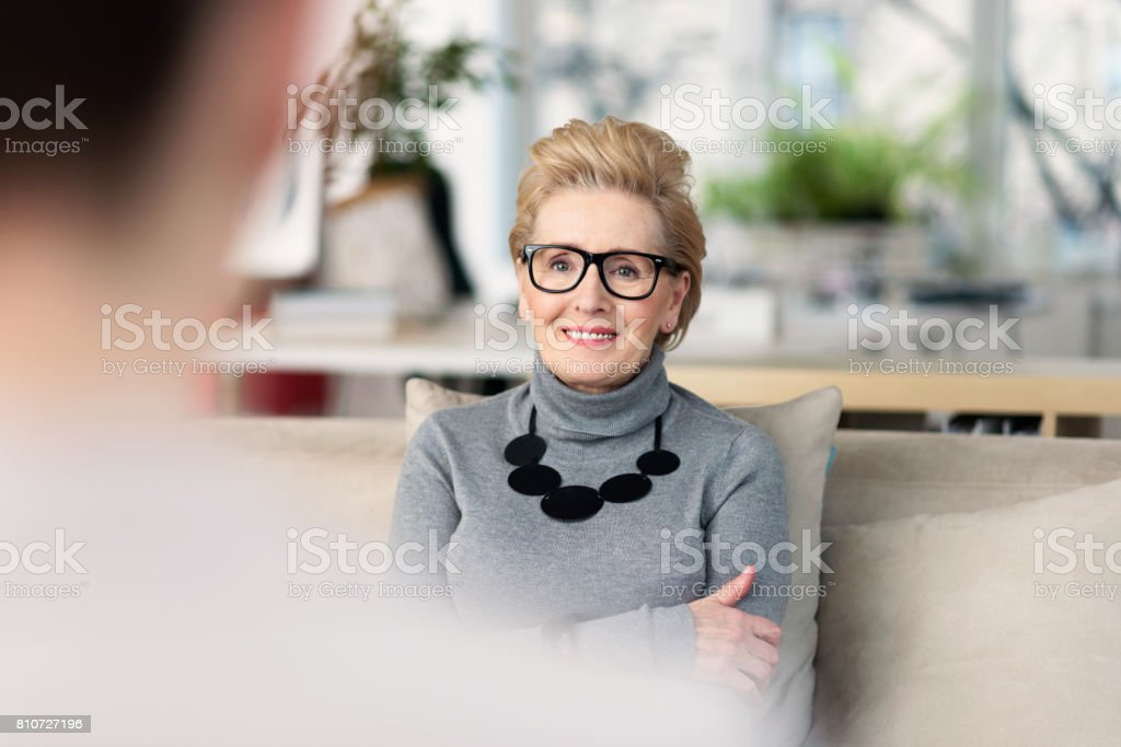 Senior adviser talking with young woman Senior woman talking with young businesswoman, giving advices. 60-69 Years Stock Photo