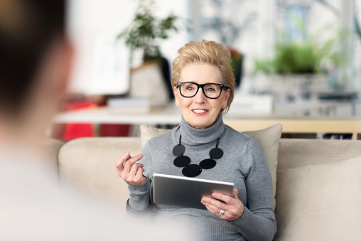 Senior Adviser Talking With Young Woman Stock Photo - Download Image Now