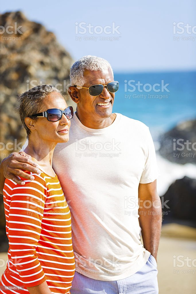 Senior African American couple embracing on beach royalty-free stock photo