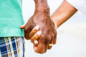 Senior African American couple holding hands at beach. Model released. Click for more similar images from this session.