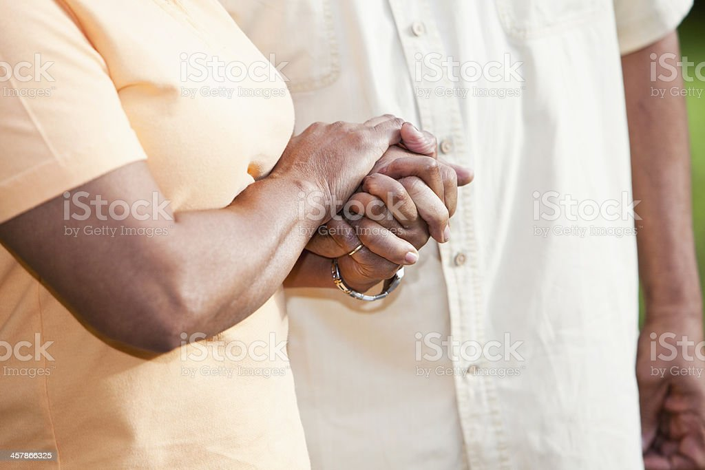 Senior African American couple holding hands stock photo