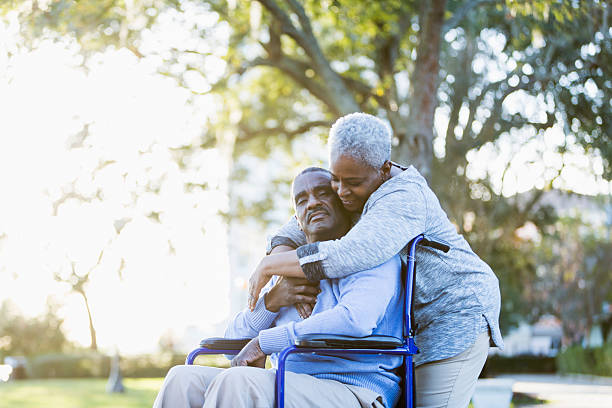 senior african american couple, man in wheelchair - stroking stock pictures, royalty-free photos & images