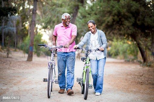 istock Senior African American Couple Riding Bikes 898372672