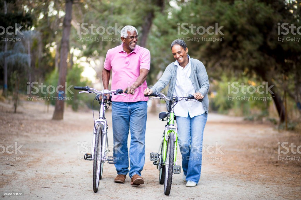 Senior African American Couple Riding Bikes stock photo