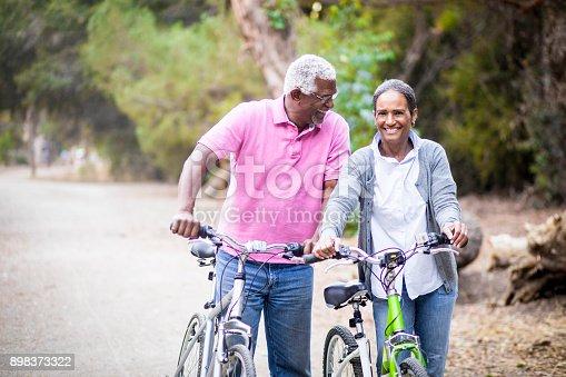 istock Senior African American Couple Riding Bikes 898373322