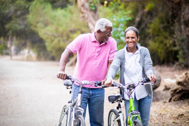 Senior African American Couple Riding Bikes stock photo