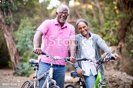 istock Senior African American Couple Riding Bikes 898373346
