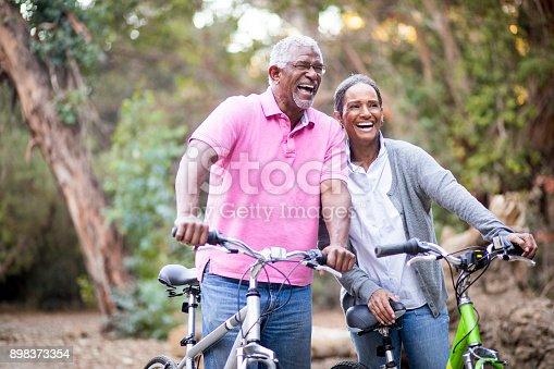 istock Senior African American Couple Riding Bikes 898373354