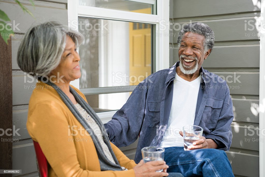 Senior African American Couple Sitting Outside House