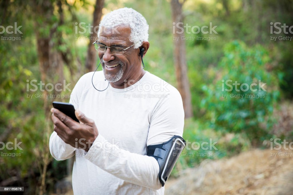 Senior African American Man Checking Smartphone stock photo
