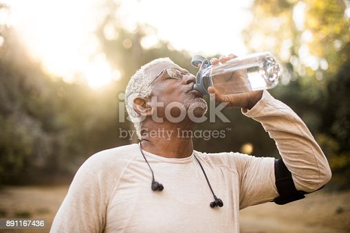 istock Senior African American Man Drinking Water 891167436