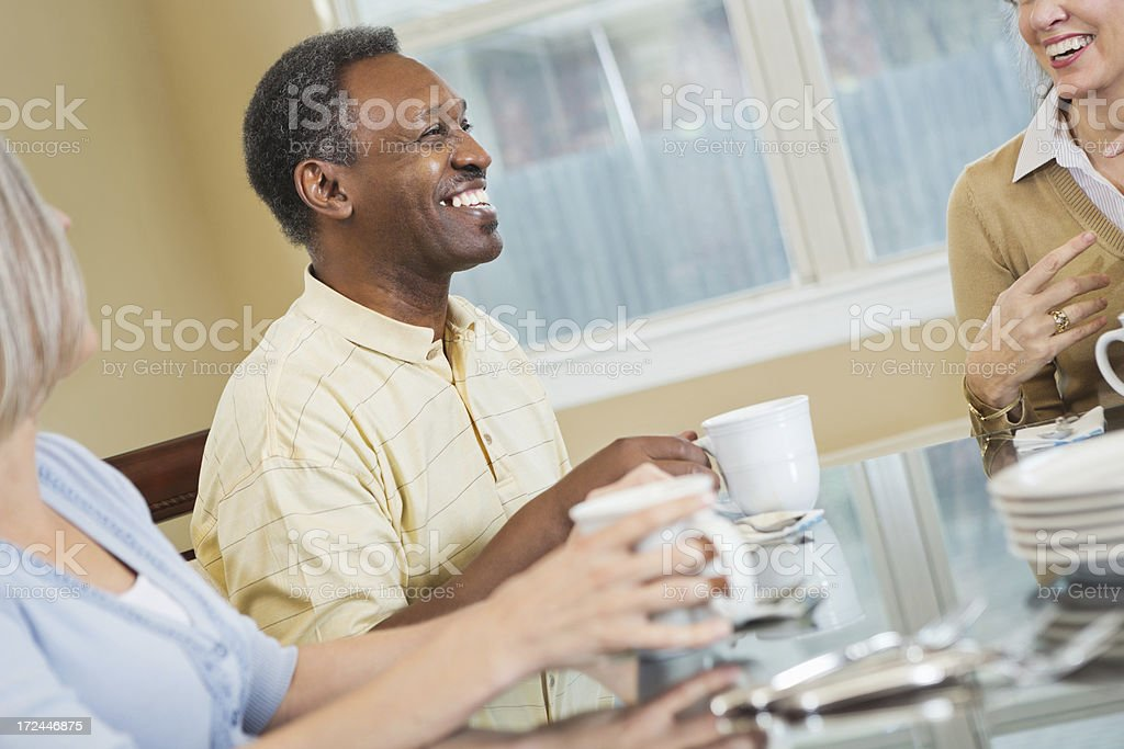 Senior African American man having coffee wtih friends royalty-free stock photo