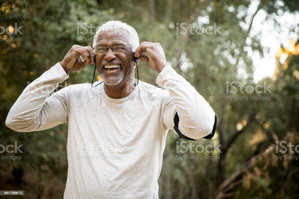 Senior African American Man Headphones Music stock photo