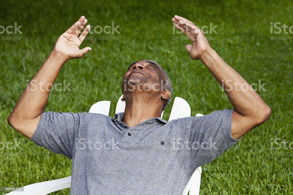 Senior African American man looking toward the sky stock photo