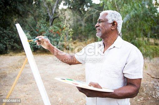 istock Senior African American Man Painting 889048814