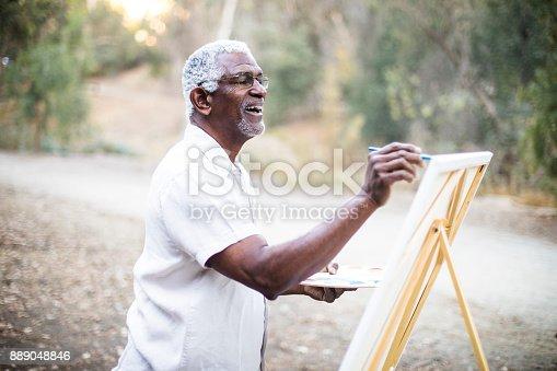 istock Senior African American Man Painting 889048846