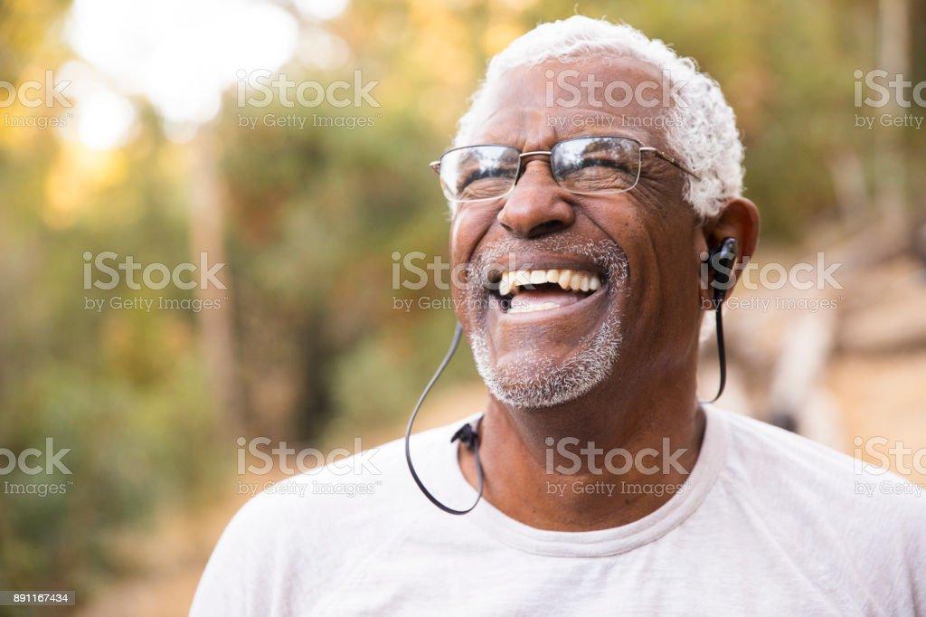 Senior African American Man Smiling During Workout stock photo