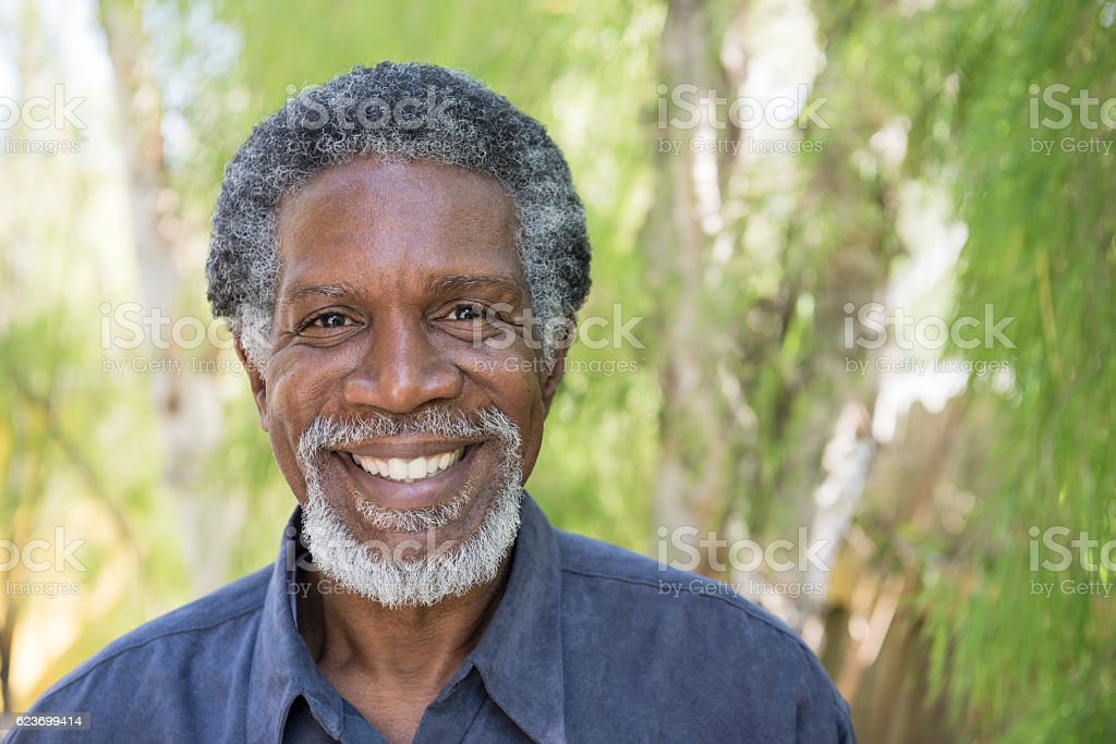 Senior African American man smiling towards camera stock photo