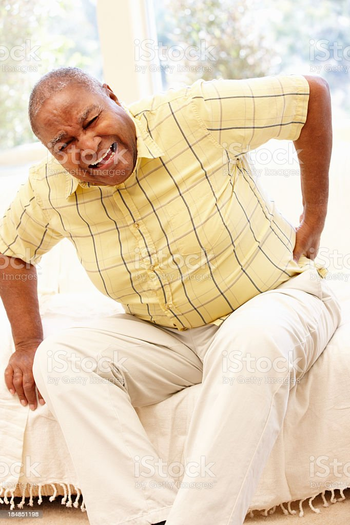 Senior African American man with backache stock photo