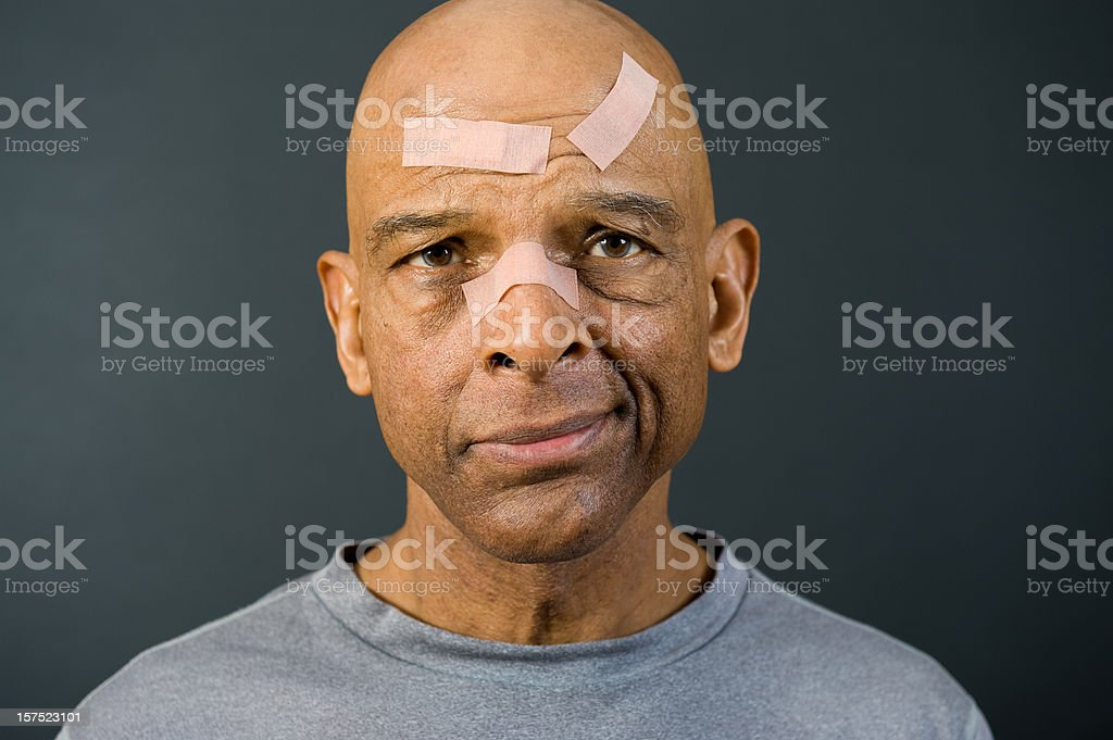 Senior African American With Bandaged Face stock photo