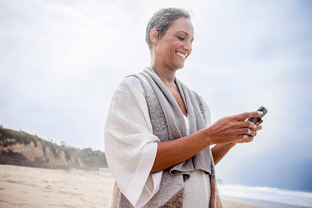Senior African American Woman Checking Smartphone stock photo
