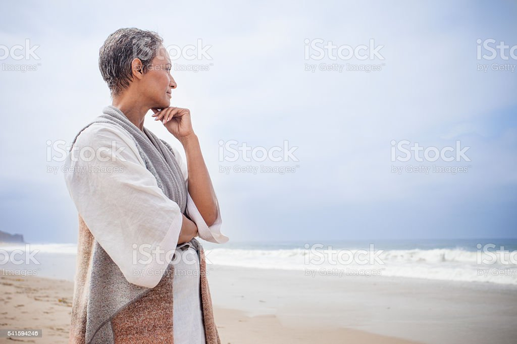 Senior African American Woman Relaxing on Beach stock photo