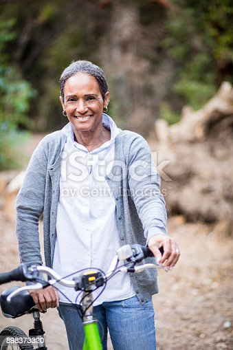 istock Senior African American Woman Riding Bike 898373320