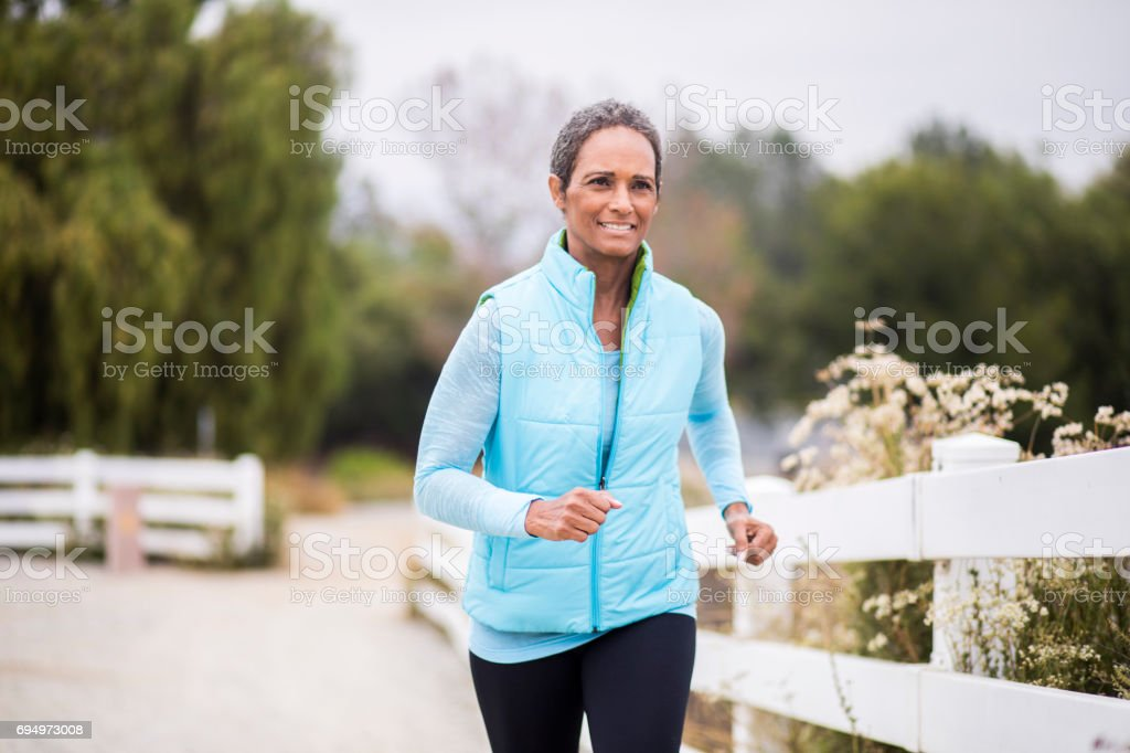 Senior African American Woman Running stock photo
