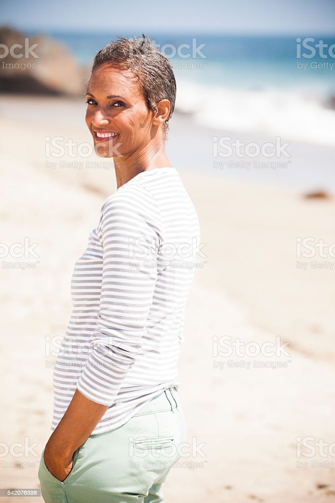 Senior African American Woman Smiling on Beach stock photo