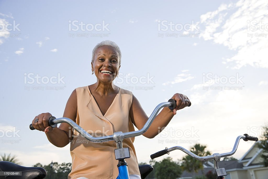 Senior African American woman with bicycle royalty-free stock photo
