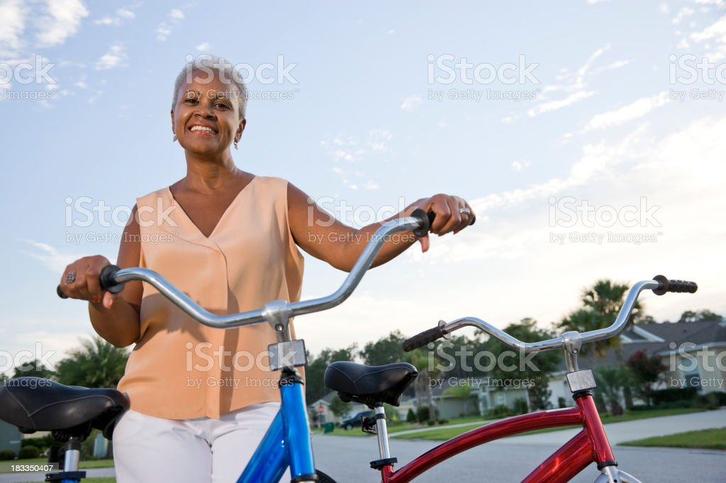 Senior African American woman with bicycle stock photo