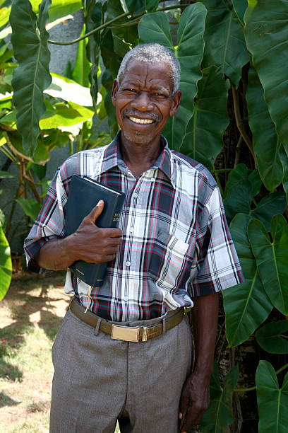 Senior African Pastor with Bible stock photo
