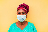 Senior african woman wearing face protective mask during coronavirus outbreak