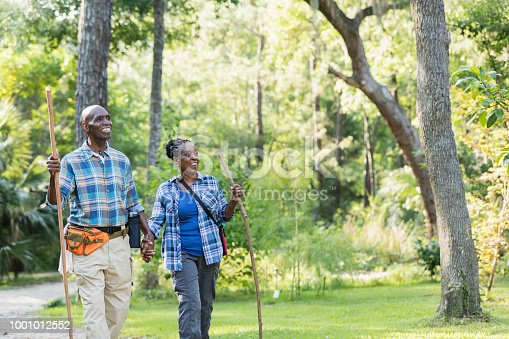 istock Senior African-American couple hiking, exploring 1001012552