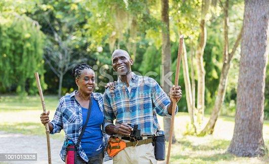 istock Senior African-American couple hiking, exploring 1001013328