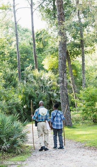 istock Senior African-American couple hiking, exploring 1023567762