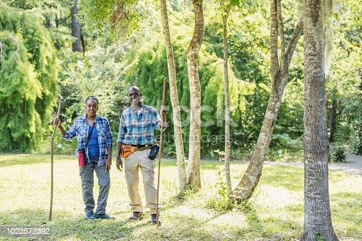 istock Senior African-American couple hiking, exploring 1023572392