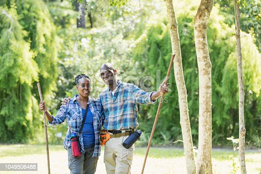 istock Senior African-American couple hiking, exploring 1049506488