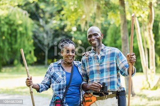 istock Senior African-American couple hiking, exploring 1094682058